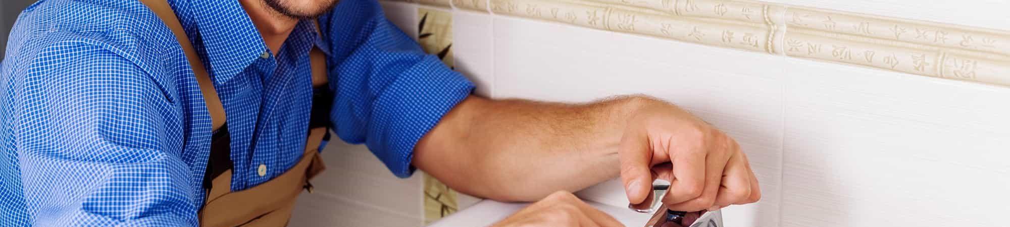 plumber-working-sink-small-bathroom-home